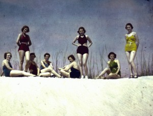 Young-women-in-swimsuits-on-sand-dune-1940s-bikini-fashion-Florida