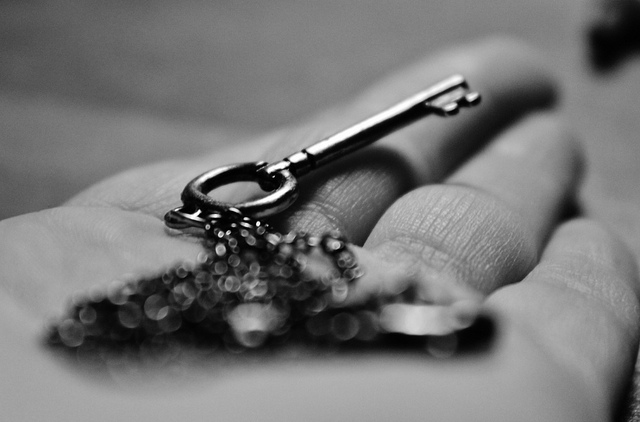 key hand holding chain