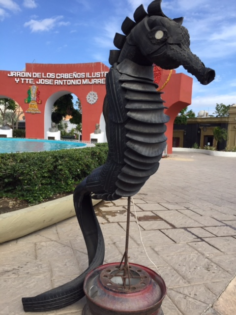 A seahorse created out of tires and rubber, a really cool piece of art