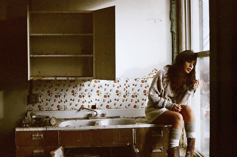 kitchen window girl sitting pensive alone