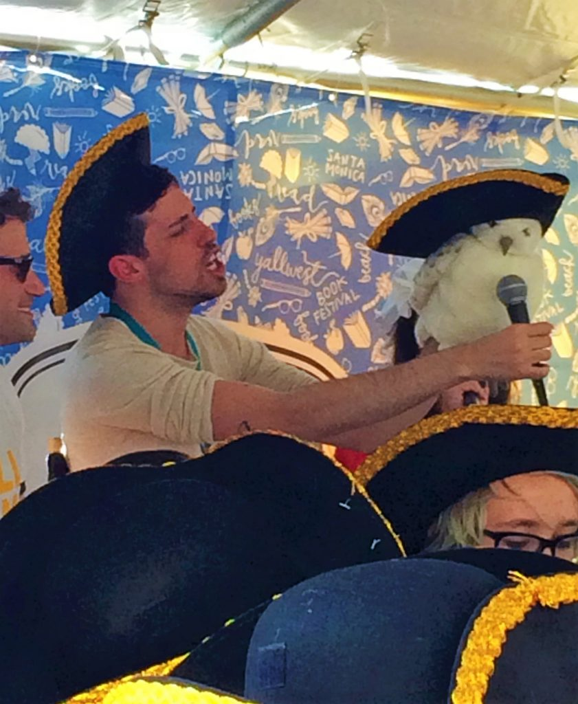 Adam Silvera at the Hamilton Singalong with a Hedwig puppet